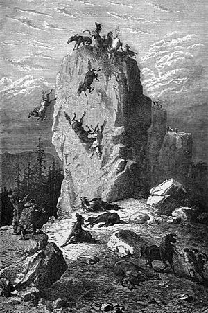 "Rock of Solutré - The Solutré horse hunt, from an illustration of ""primitive man"" by L. Figuier, 1876"
