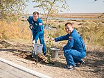 Soyuz MS-10 crew during the tree planting ceremony.jpg