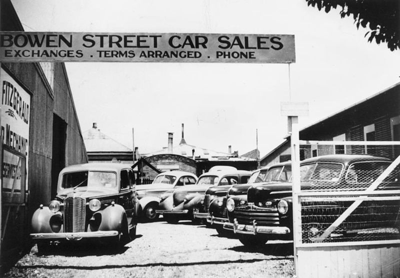 File:StateLibQld 1 124639 Motor vehicles for sale at Bowen Street Car Sales, Toowoomba, ca. 1945.jpg