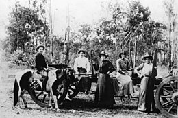 StateLibQld 1 190687 Timber worker sisters from the Lynch family, pictured with Jim Hunter on his paint pony, ca. 1900.jpg