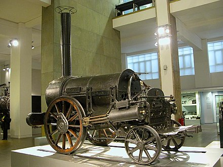 The railways changed communications and society dramatically Stephenson's Rocket.jpg