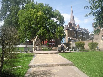 Streatham - Streatham Green with the spire of the Catholic English Martyrs Church beyond.