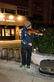 Street Musician Playing Violin in Time Square Building, Songshan District, Taipei 20150123.jpg