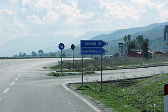 Gjirokastër - Bilingual sign in the Greek Minority Zone on the SH4.