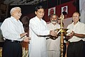 Sudarshan Bhagat lighting the lamp to inaugurate the Swachh Udyami Yojna, in New Delhi on October 02, 2014. The Secretary, Ministry of Social Justice & Empowerment, Shri Sudhir Bhargava is also seen.jpg