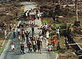 Sumatrans waving to MH-60S Knighthawk 1-13-05 050113-N-8629M-381.jpg