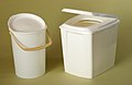 TOA Luxus mobile toilet with buket beside (3944053363).jpg