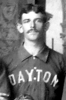 "A man wearing baseball jersey with ""Dayton"" written on the front."