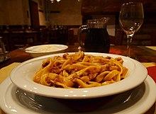 Tagliatelle al ragu Bolognese as served in Bologna .