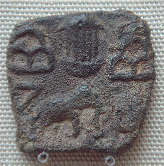 Pandyan dynasty - Temple between hill symbols and elephant coin of the Pandyas Sri Lanka 1st century CE.