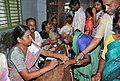 The Polling Officer administering indelible ink at the finger of a voter at a polling booth at Mylavaram, in Vijayawada, Andhra Pradesh, during the 2nd Phase of General Election-2009 on April 23, 2009.jpg