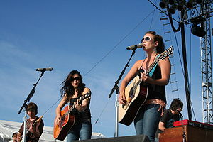 The Wreckers (Michelle Branch (center), Jessica Harp (right)) performing in June 2007, just over a month before their break-up