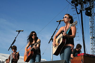 Michelle Branch (center) during a June 2007 concert with Jessica Harp (right) as The Wreckers. The Wreckers on stage.jpg