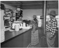 Three Navajo individuals making purchases at general store - NARA - 295154.tif