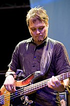 A man playing a bass guitar