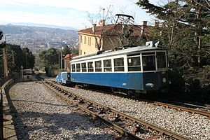 Trieste–Opicina tramway - Opicina Tramway, on the cable-hauled section. The city of Trieste can be seen in the background.