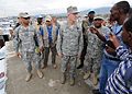 U.S. Air Force Gen. Douglas Fraser, commander of U.S. Southern Command, listens to a camp leader at Ancien Aeroport Militaire in Port-au-Prince, Haiti, March 6, 2010 100306-N-HX866-014.jpg