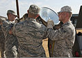 U.S. Air Force Staff Sgt. Nathaniel McLeod, Senior Airman Nicholas Buffo, Airman 1st Class Austin Simoneau, Airman Mark Esparza, and Airman Colt Dodd, all with the 366th Training Squadron, remove a light 110725-F-NS900-015.jpg