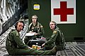 U.S. Air Force aircrew members with the 34th Aeromedical Evacuation Squadron, Peterson Air Force Base, Colo., listen to feedback from an observer-controller-trainer during a flight aboard a C-17 Globemaster III 140313-F-XL333-415.jpg