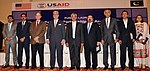 U.S. Consul General Zachary Harkenrider, Director USAID Punjab Dr. Miles Toder,and Senior Vice President of the LCCI Almas Hyder with representatives of four Pakistani banks at the launch (22300525580).jpg