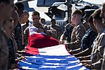 U.S. Marines and Sailors assigned to the 26th Marine Expeditionary Unit (MEU), and Sailors assigned to the USS Kearsarge (LHD 3), fold the American flag to commemorate the Fourth of July during their 2013 130704-M-BS001-011.jpg