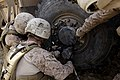 U.S. Marines with Combat Logistics Regiment 2 help Marines with the 3rd Battalion, 9th Marine Regiment change a tire during a combat logistics patrol to Forward Operating Base Payne March 23, 2013, in Helmand 130323-M-KS710-060.jpg