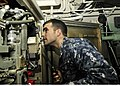 U.S. Navy Fire Controlman 2nd Class Nathaniel Hebert, assigned to the guided missile cruiser USS Bunker Hill (CG 52), inspects an MK 99 transmitter prior to performing maintenance on the ship while at sea in 120809-N-AU127-973.jpg