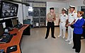 U.S. Navy Mineman 1st Class Toby Mozek, left, gives Vice Chief of Naval Operations Adm. Mark E. Ferguson, second from right, a tour of the master control room in the destroyer simulator USS Trayer (BST 21) at 120921-N-IK959-077.jpg
