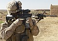 U.S. Navy Seaman Garry Phillip, a corpsman attached to Bravo Company, 1st Battalion, 9th Marine Regiment, looks through his scope for possible threats while on patrol in Boldak, Helmand province, Afghanistan 131219-M-WC184-240.jpg