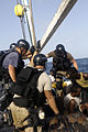 U.S. Navy and Marine Corps visit, board, search and seizure team members stationed aboard the guided missile cruiser USS San Jacinto (CG 56) stand guard over suspected pirates on board a dhow as they travel 100527-N-EF447-006.jpg