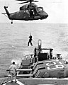 UH-2 of HC-7 lifting man from USS Lofberg (DD-759) 1970.jpg