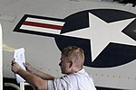 USS Carl Vinson sailor preps to remove plane wing 120204-N-RG587-009.jpg