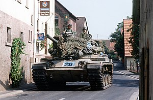 M60 Patton - M60A1 tank of the U.S. Army maneuvers through a narrow German village street while participating in the multi-national military training exercise, REFORGER '82.