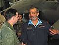 US Navy 030227-N-1050K-043 Maj. Gen. Ahmad Y. Al Mulla, Kuwaiti Chief of Naval Forces, discusses hangar bay operations with Aviation Boatswain's Mate 2nd Class James Penkert during a recent visit.jpg