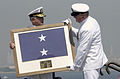 US Navy 030905-N-8590G-012 Rear Admiral Robert C. Chaplin receives his flag from Commander, Naval Forces Japan (CNFJ) Command Master Mike Driscoll during the CNFJ Change of Command ceremony in which RADM Chaplin was relieved by.jpg