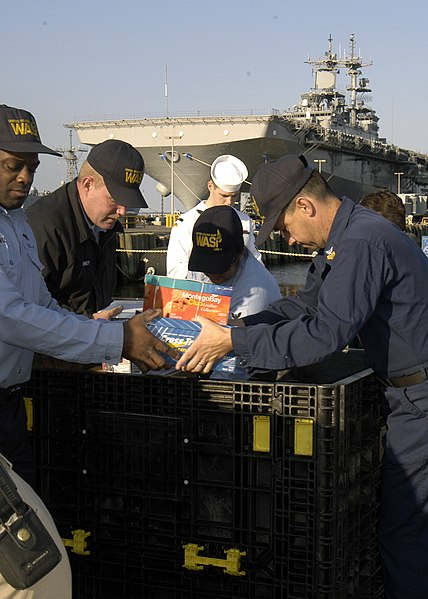 File:US Navy 031005-N-6380E-025 A ten-man working party loads crates with care packages.jpg