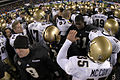 US Navy 031206-N-0399H-527 Army and Navy football players meet in the center of the field to congratulate each other on a good game following the Army Navy game.jpg