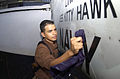 US Navy 040805-N-3488C-005 Airman Rigoberto Vargas from Miami, Fl. cleans an engine door on an F-A-18F Super Hornet aboard the aircraft carrier USS Kitty Hawk (CV 63).jpg