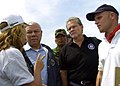 US Navy 050105-N-6020P-076 Secretary of State Colin Powell talks with relief aid workers during a tour of the Banda Ache, Sumatra, Indonesia airport.jpg