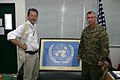 US Navy 050131-M-1158H-029 The Commanding General of III Marine Expeditionary Force and Commanding General of Combined Support Force-536 Lt. Gen. Robert R. Blackman, is presented the United Nations flag.jpg