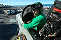 US Navy 050618-N-5781F-188 Photographer's Mate 3rd Class Matt Craven conducts weapons release checks on an F-A-18F Super Hornet, assigned to the Diamondbacks of Strike Fighter Squadron One Zero Two (VFA-102).jpg