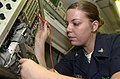 US Navy 050715-N-1730J-039 Aviation Electronics Technician 3rd Class Miranda Golden of Medford, Ore., reads a digital multi-meter while troubleshooting a signal generator.jpg