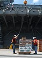 US Navy 050920-N-9867P-005 Civilian contractors load pallets of food supplies onto the amphibious assault ship USS Bataan (LHD 5) while pierside in Mayport, Fla.jpg