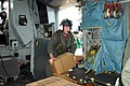 US Navy 050924-N-4781D-004 A U.S. Navy aircrew member from an MH-53E Sea Dragon helicopter, assigned to Helicopter Mine Countermeasures Squadron Fourteen (HM-14), loads Meals Ready-to-Eat (MRE).jpg