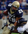 US Navy 051015-N-9693M-005 U.S. Naval Academy Midshipman slot back Marco Nelson is tackled by Kent State Golden Flashes defender Dennis Pittman.jpg