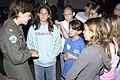 US Navy 060419-N-4021H-013 Lt. Renee Scherr assigned to Commander Helicopter Sea Combat Wing Pacific speaks to a group of 5th grade girls during a career day at Meridian Elementary School.jpg