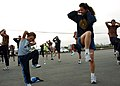 US Navy 060825-N-3560G-007 Construction Mechanic 1st Class Dawn Ayala assigned to Naval Mobile Construction Battalion Four (NMCB-4) and his son, warm up before a family formation run.jpg