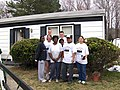 US Navy 070324-N-2257A-029 Sailors from Precommissioning Unit (PCU) George H. W. Bush (CVN 77) pose with the owner of a refurbished house as part of the Paint the Town community improvement project.jpg
