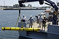 US Navy 070611-N-7676W-097 The Midsize Automated Research Vehicle (MARV) is hoisted aboard Project Support Craft (PSC) 12 following pierside testing during Autonomous Underwater Vehicle (AUV) Fest 2007, hosted by the Naval Surf.jpg