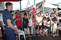 US Navy 070630-N-9421C-218 Pacific Partnership mission commander, Capt. Bruce Stewart gives his closing remarks to the local citizens thanking them for welcoming amphibious assault ship USS Peleliu (LHA 5) Sailors to their beau.jpg